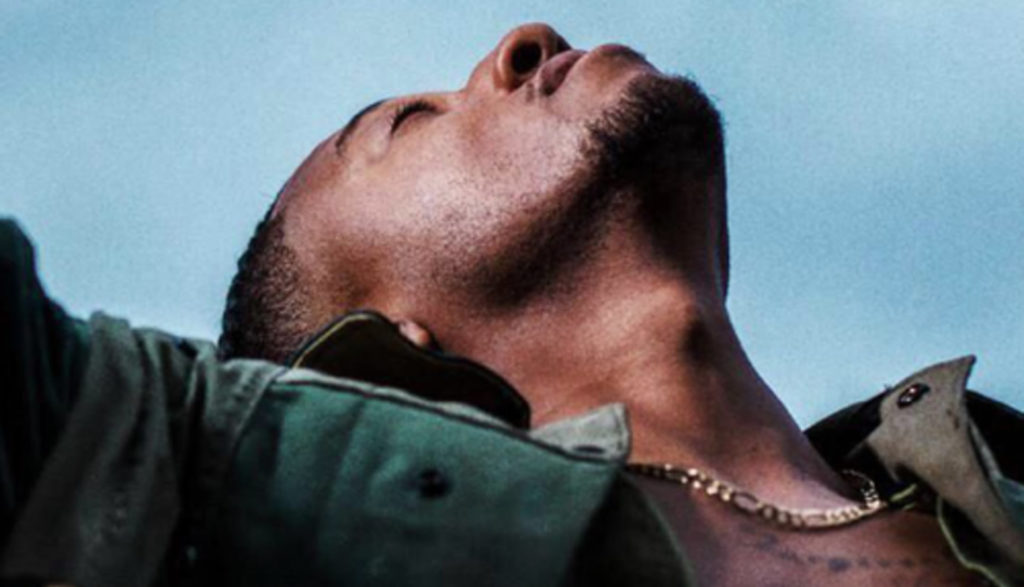 Christian rapper Lecrae's latest album shows him lifting arms up and looking toward the sky in a prayerlike pose.