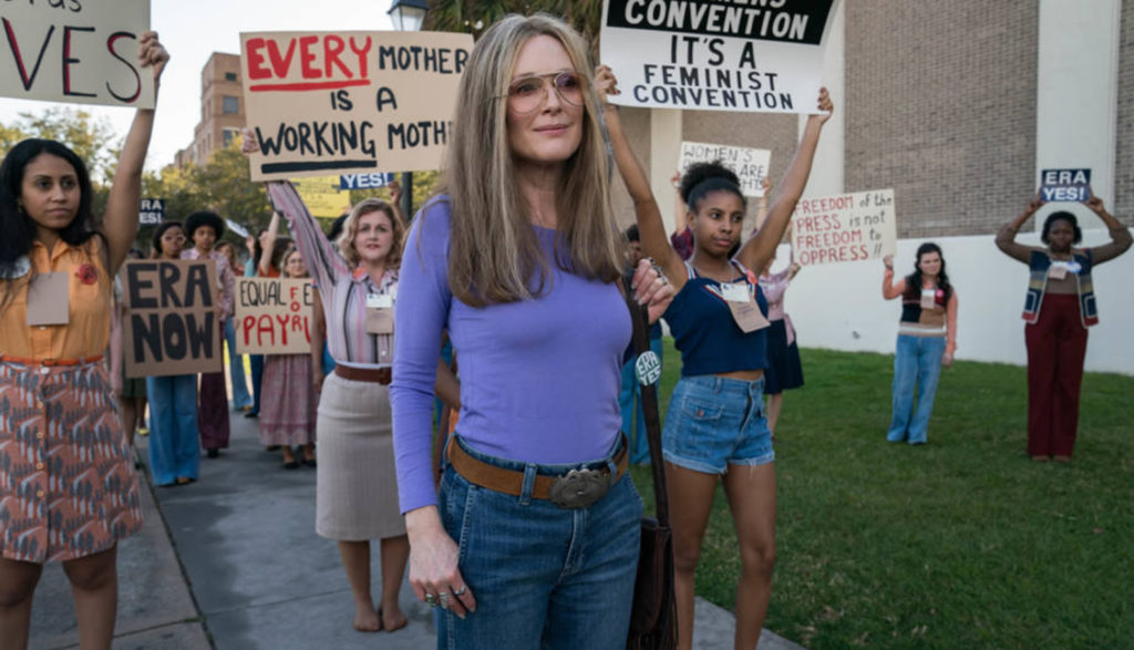 Actress Julianne Moore as Gloria Steinem at a women's rights rally.
