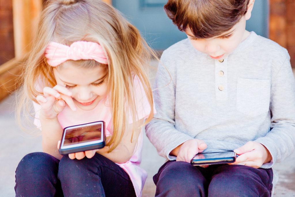 Kids looking at phones