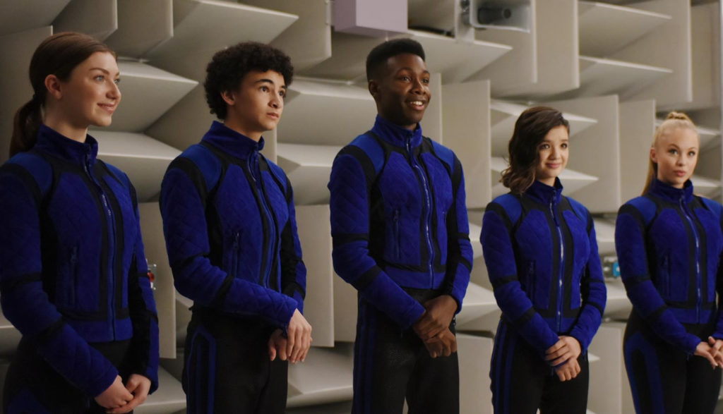Five super-powered teens line up in blue uniforms.