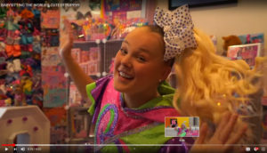 Screen shot of smiling Jojo Siwa from her YouTube Channel