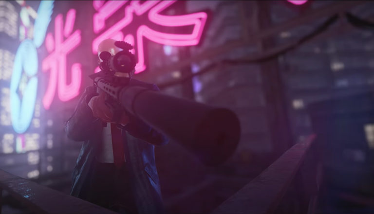 Screenshot of an assassin pointing a gun in the game Hitman 3.