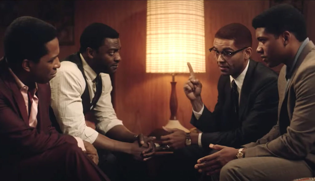 Malcolm X, Cassius Clay, Jim Brown and Sam Cooke talk in a hotel in the movie One Night in Miami.