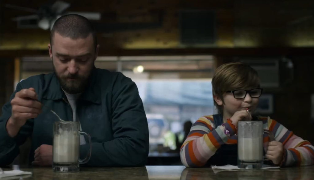 A man and a boy eat at a diner.