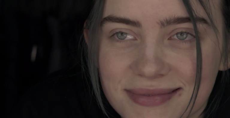 A close-up portrait photo of young rock singer Billie Eilish.