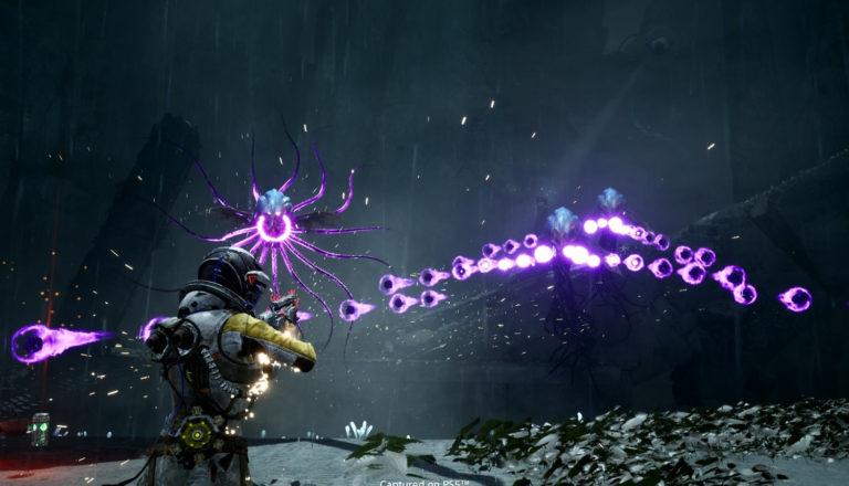 "Screen shot of an astronaut shooting an alien in the sci-fi horror video game ""Returnal."""