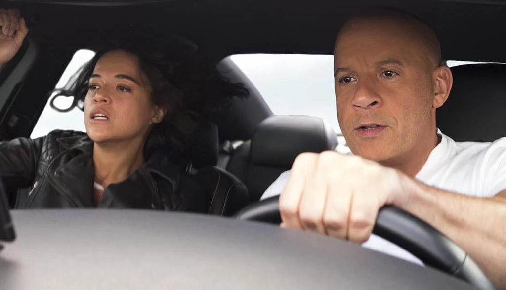 Dom and Letty from the Fast and Furious franchise in a car together.