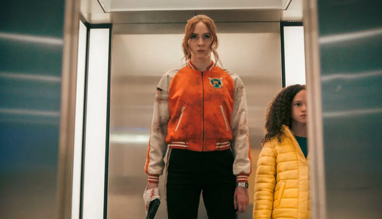 woman and girl on an elevator with a gun