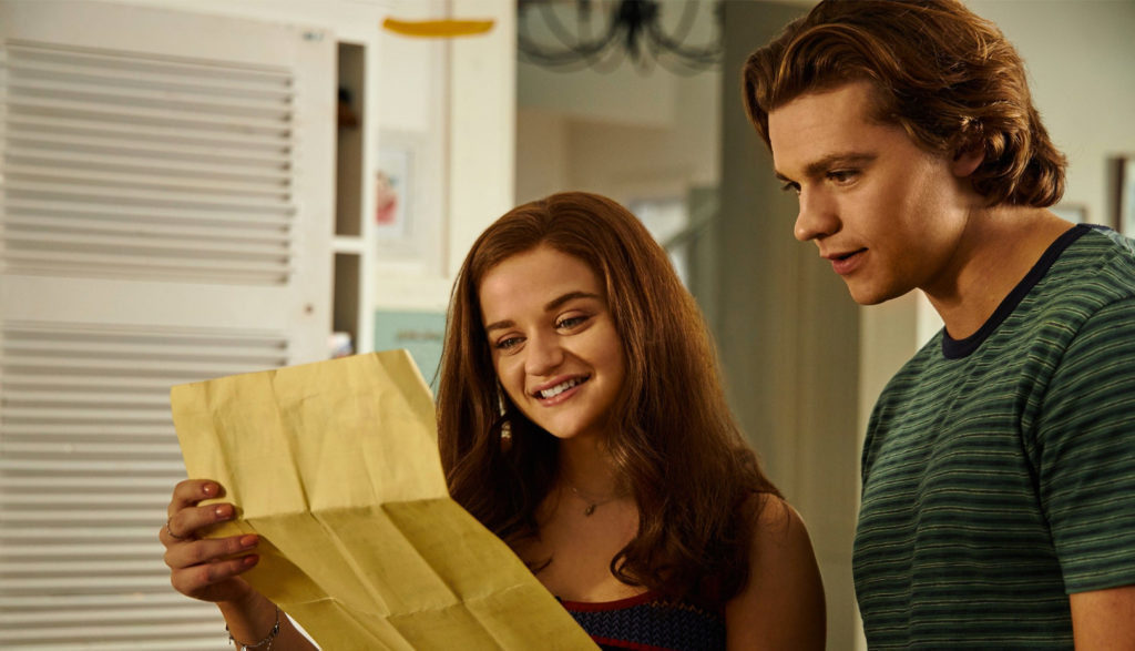 Two teens reading a letter